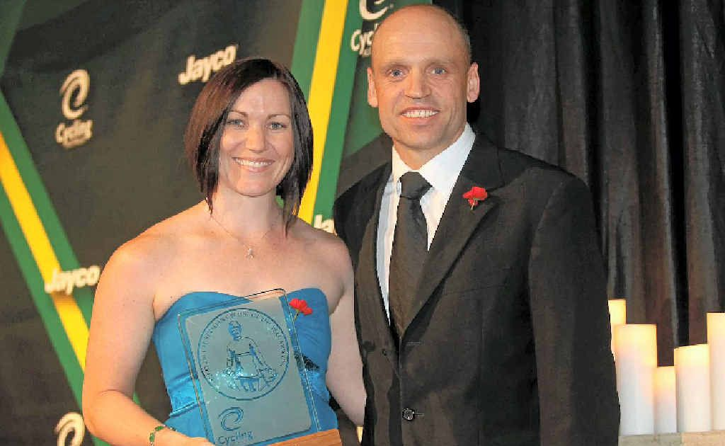 Federal Australian Sports Minister, Senator Mark Arbib, presenting the Scody People's Choice Cyclist of the Year trophy to Anna Meares at the Australian cyclist of the year awards.