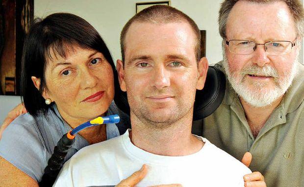 Paraplegic Jarrad Quinn with his mother Jude and stepfather Derek Laird.