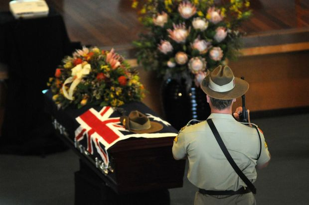 Cpl Ashley Birt's funeral at the Pavilion in Gympie. An escort stands guard at the casket.