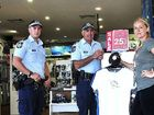 Senior Constable Richard Whatman, Constable Alex Heaney with Rush store manager Boe Tracey.
