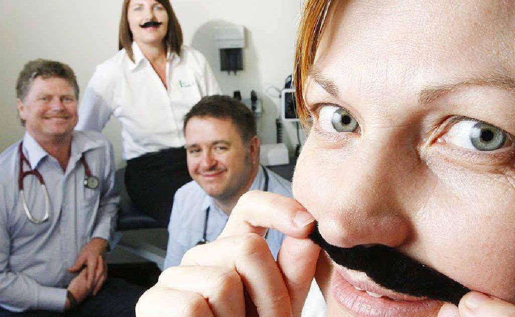 UQ Health Care practice manager Vanessa Stamp joins doctors Simon Barnett and Rob Kielty and staff member Michele Stumpf donning moustaches for men's health.