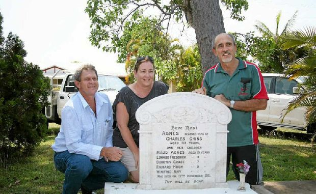 Descendents of the survivors, including (from left) Paul Steindl, Hanni Steindl and Lance Steindl, at the family grave in Sarina Cemetery, will meet this week to pay their respects to their slain ancestors.