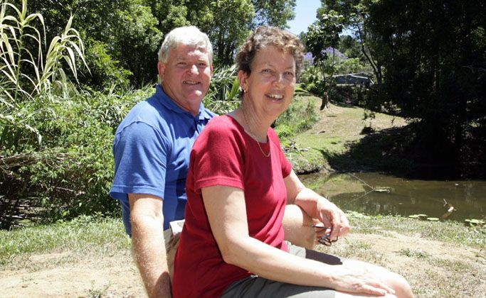 John and Kay Turner sit among the colony of bats that run along properties in their neighbourhood.