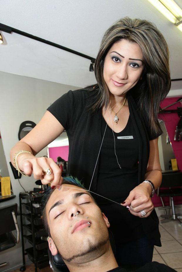 """Fariba Jaberi """"threads"""" fine hairs from a customer's face."""