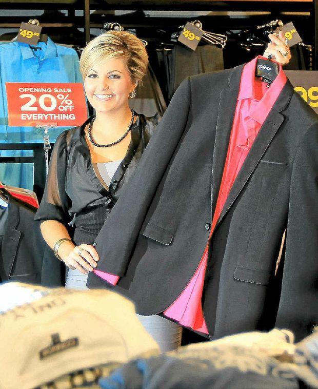 Connor men's wear store Tweed City manager Belinda Hazel-Unus shows some of the stock.