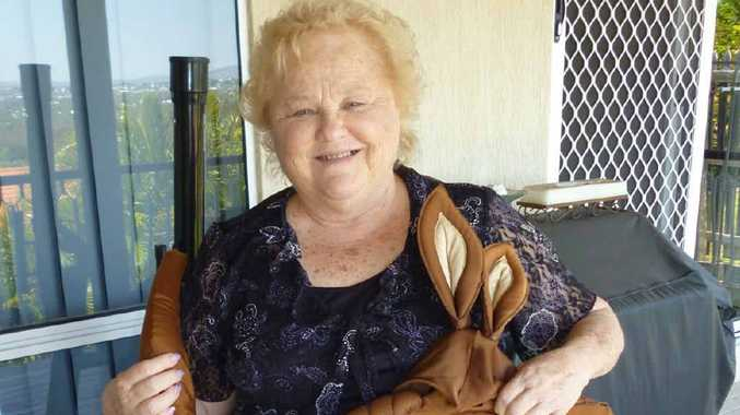Shirley Mathers, who was in Matilda at the 1982 Brisbane Commonwealth games opening ceremony, holds a joey's costume from the event.