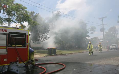 Fire crews fighting to contain the blaze in Balaclava St, North Rockhampton.