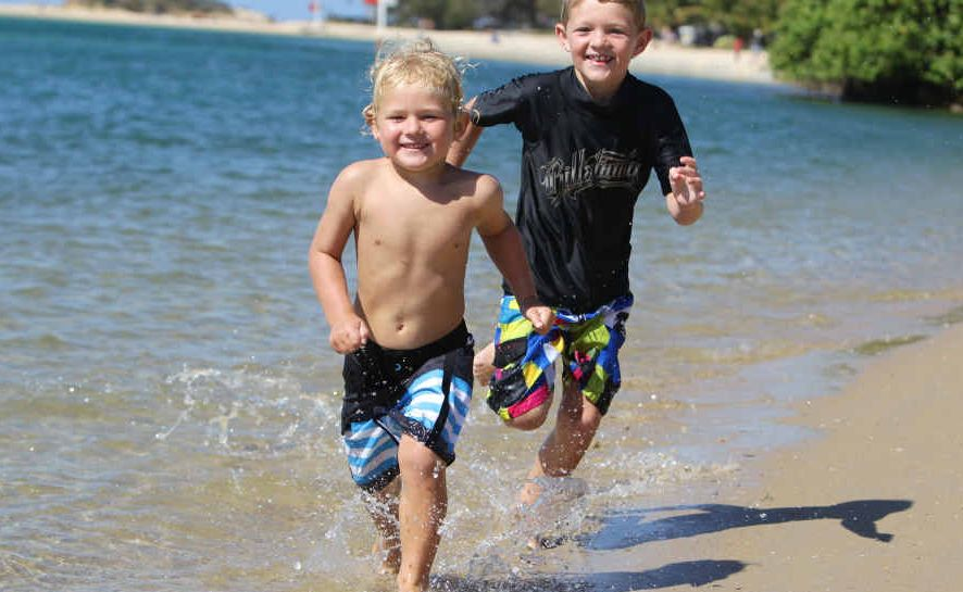 Four-year-old Corey Preston and his seven-year-old brother Matt McQuarrie, of Marcoola, play in the Maroochy River.