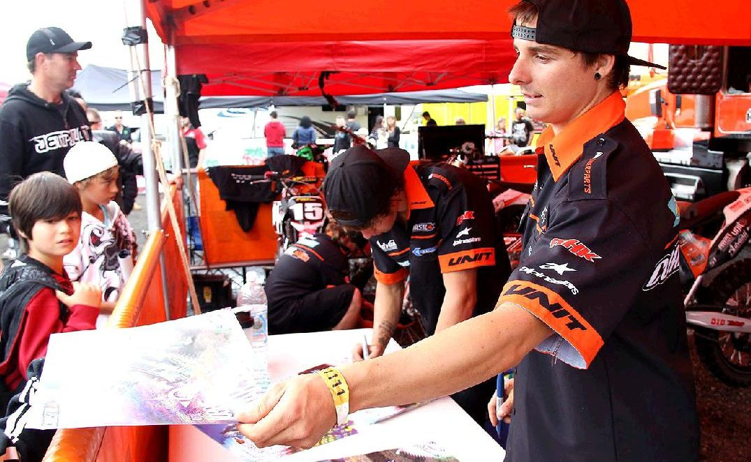 Robbie Marshall signing posters and autographs for motor sport fans prior to this weekend's big race at North Ipswich Reserve.