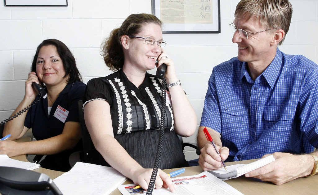 Adopt a Family volunteers Yvonne Merbach, Bianca Seemann and Pastor Gary Schultz are ready to take your call for the Christmas appeal.