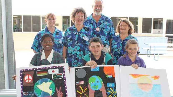 PEACEFUL DISPLAY: Airlie Beach Lions Club members Coral Salmon, Sandra Hardy, Alan Browning and Robina Mealey presented prizes to Whitsunday Christian College peace poster entrants Karita Supramanim, Andrew Bickhoff and Caitlin Hutchinson on Monday. Photo Aimee Vinci / Whitsunday Times