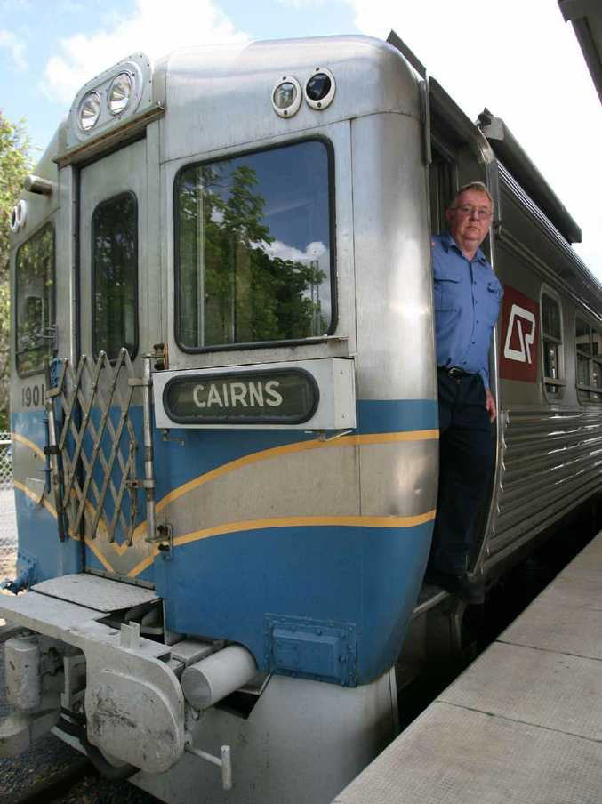Driver Rod Andrew enjoys a break as the historic stainless steel train makes a stop in Rockhampton on its way to Cairns.