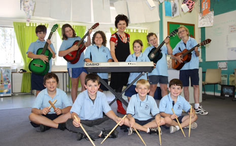 LOYAL TEACHER: Pictured with Ropeley students, music teacher Christina Martin was awarded a 20 year badge last week for her services in Queensland education.