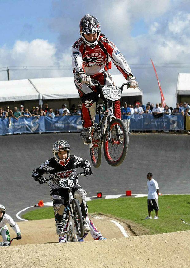 Mackay BMX star Melinda McLeod is airborne as she negotiates a jump.