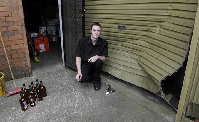 Stock Exchange Hotel staff member Aaron McCluskey inspects the damage.