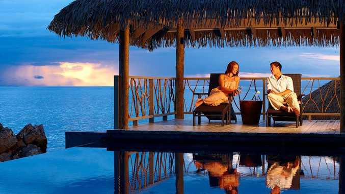 SIT BACK AND RELAX: After dinner, relax on the poolside deck at Tadrai Resort on Mana Island in Fiji.