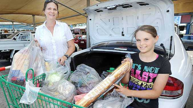 Julie Thomson and daughter Jessica, 9, do their weekly shopping at Woolworths.