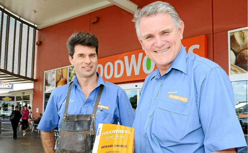 Produce manager Jim Liolios and Foodworks store manager John Learmonth with the Queensland Retailer of the Year Award.