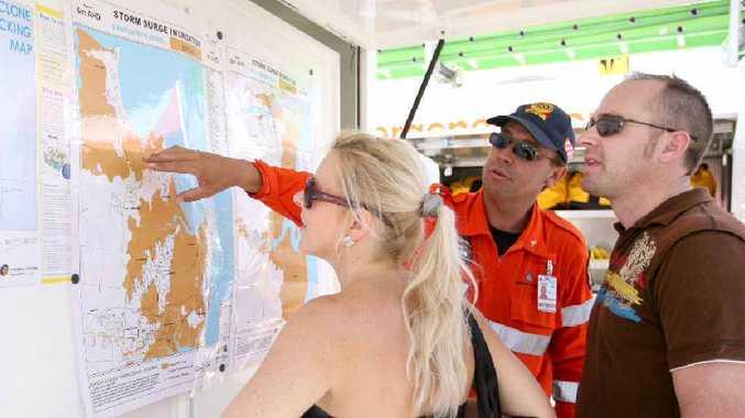SES volunteer John Williamson explains cyclone preparation and flood zones to Mackay residents Emma Davis and Darren Pugh at Cyclone Saturday, held at McGinns at the weekend.