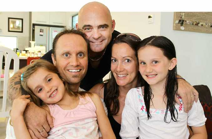 Tony Sells with Nick and Allison Duggan and their children Dakota, 5, and Jessilee, 8.