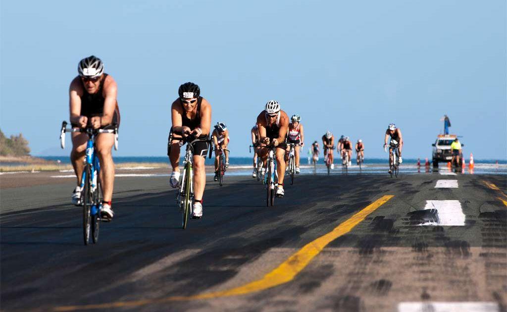 BIKING IT: Competitors race across the runway during the bike leg of the Hamilton Island triathlon.
