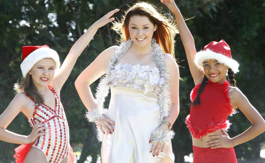 Dancers Hayley Else and Katie Bell, with soloist Krystel Spark, rehearse for the Brassall Christmas in the Park.