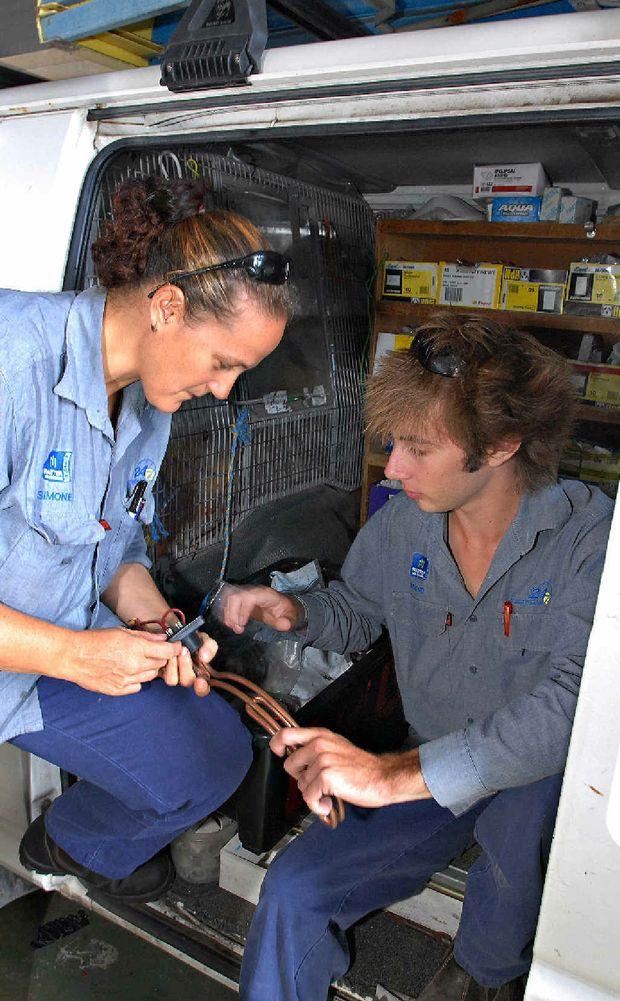 Apprentice electricians Semon Modra and Steven Black in Mackay.