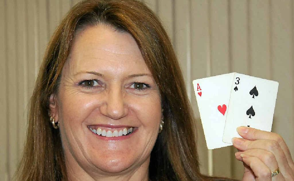 Thea Mapes with the final two cards which won her an Australian Pro Poker League national title.
