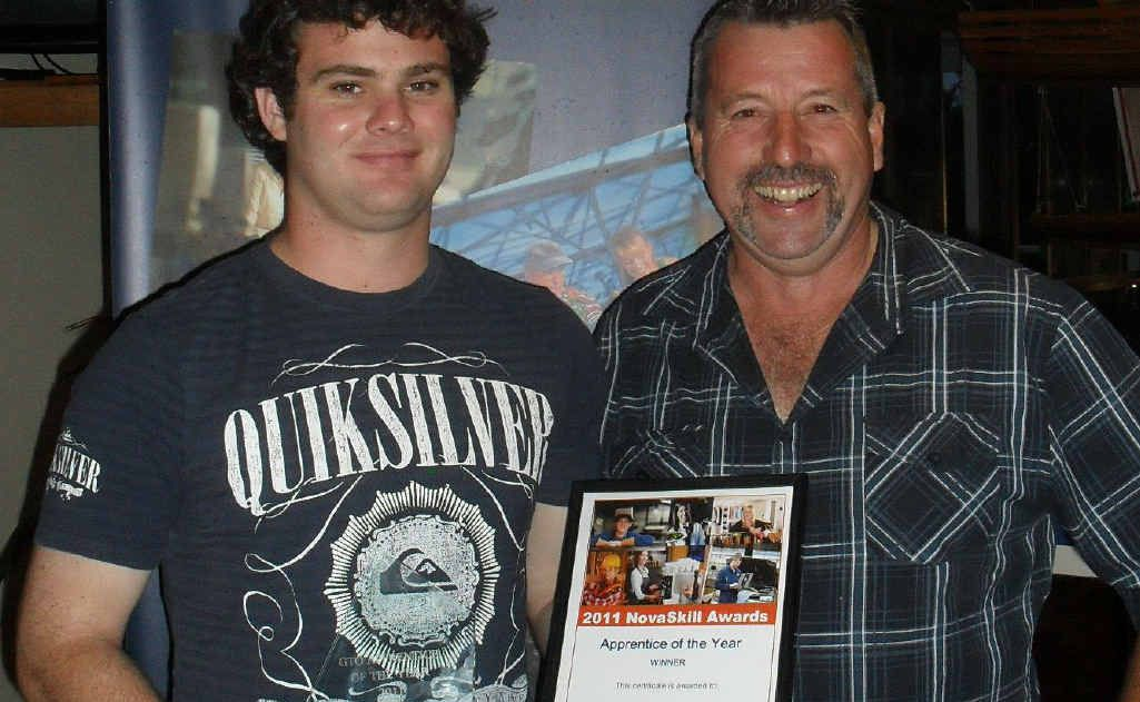 Coffs Harbour City Council Novaskill Apprentice of the Year Luke Abercrombie accepts the award from his supervisor Neil Manson.