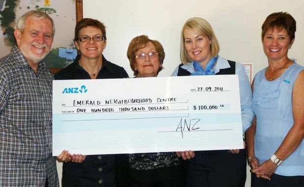 The ANZ Bank presents the Neighbourhood Centre's Lorna Hicks with a $100,000 cheque as part of its commitment to supporting long-term recovery efforts in flood-affected areas of Queensland.