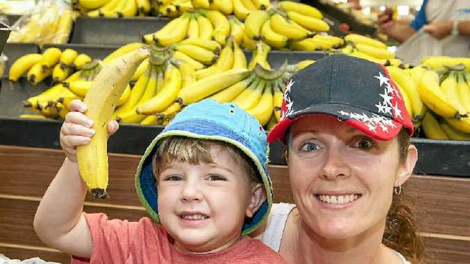 Lyndrea Lynch and her three-year-old son Hayden stock up on cheap bananas.