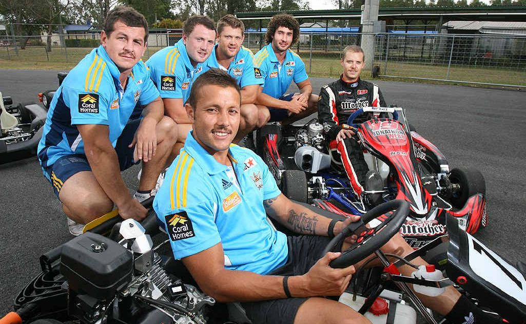 The Gold Coast Titans enjoyed some fun times on the track at the Ipswich Motorsport Precinct Go-Kart track on Wednesday with V8 Supercar driver Jonathon Webb (right).