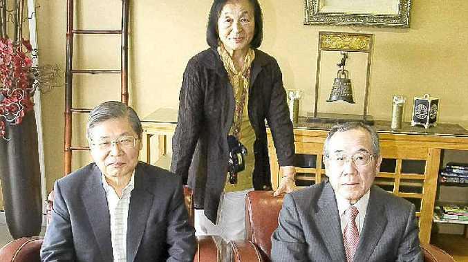 Visiting business leaders (From left, sitting) Kazuyuki Takaki of the Hiroshima Keizai Doyukai group and Masao Nagano, president of Shinhiroshima Telecasting Co Ltd. (Standing) Tazuko McLaren, SCU Japanese student liaison officer.