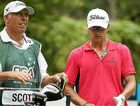 Caddie Steve Williams and Adam Scott discuss club selection.