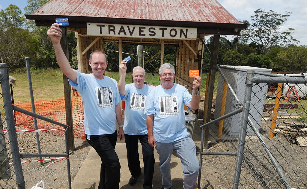 Jeff Addison, Brian O'Connor and Robert Dow, of Rail Back On Track rail advocacy group, stop at Traveston Station to celebrate the good news that it will remain open and operational thanks to the decision by Qld Rail to Restore the shelter.