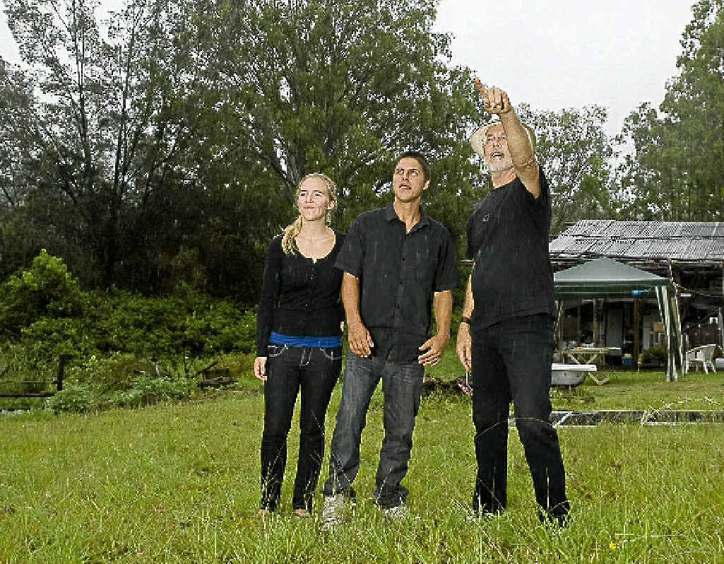 Steven Biedrowski and Nicole Stokes are shown their plots of land by property developer jonathan of the Eden Creek Community Project, who has seceded from Australia.