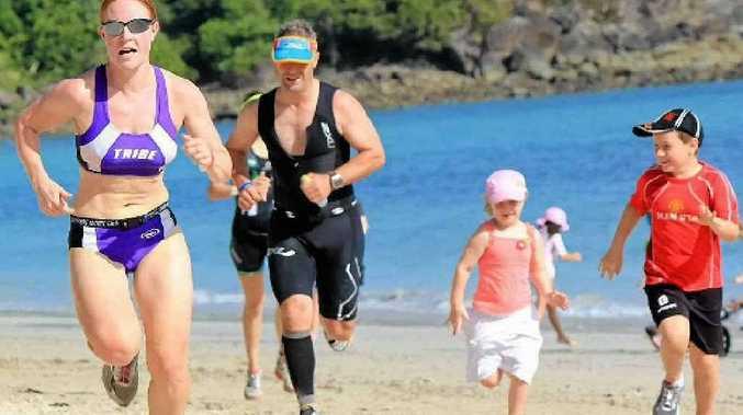 Jenni Bailey runs to the finish line in the Hamilton Island triathlon.