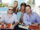 Attending the Sunshine Coast's biggest outdoor picnic at Happy Valley recently are MasterChef stars George Calombaris and Gary Mehigan with Krystal Reynolds, left, and Debbie O'Keefe.