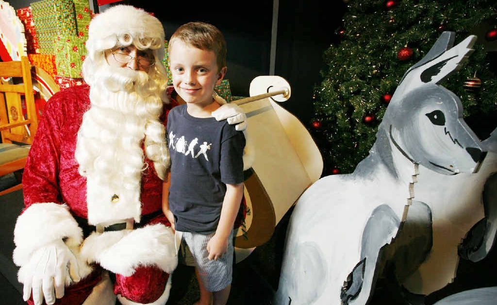 Ridley Whittington, 6, of Ormeau with Santa at The Workshops Rail Museum.