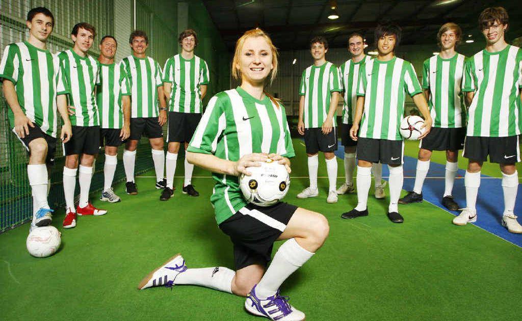 Girls team captain Angie Sullivan (centre) with South East Queensland Indoor Soccer Super League men's team Ipswich.