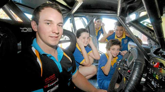 Justin Garioch fires up his V8 racer for Mackay West Year 6 students Alicia James, Hannah Holden, Ryan Tilse and John Iker.