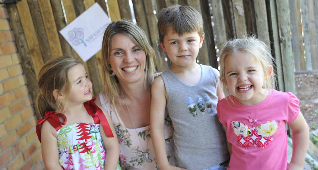 Kim Fraser with twins Evie and Lila, 3, and Casey, 4, balances her business Wa Wa Tree children's clothing range with family life.