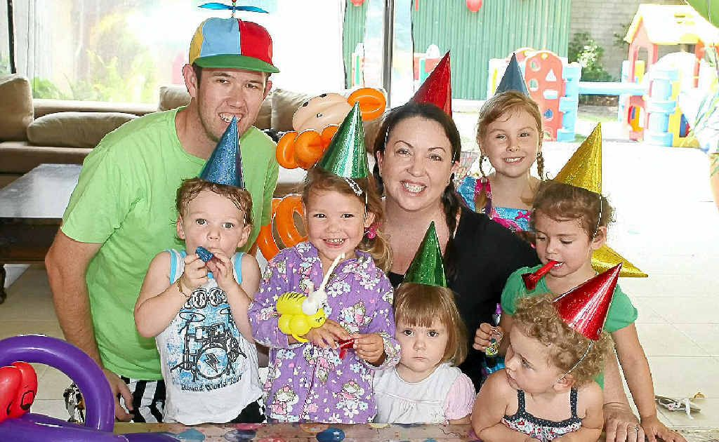 Happy Home Childcare's Annie Scanlon and TwistedMr's Matt Russell and with some happy kids, prepare for the New Year's Eve fun.