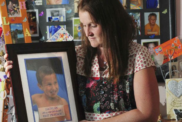 Kristy Pace looks at a photo of her son Lachlan, who drowned in his bath in 2008 during an epileptic fit.