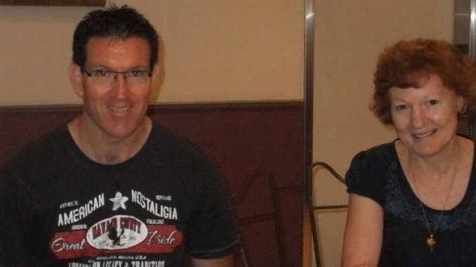 Mackay Road Runners member Shawn Claydon chats with incoming club secretary Teresa Robinson.