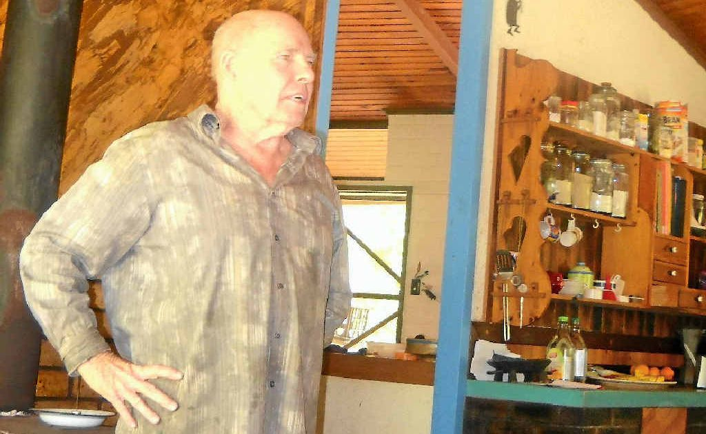 Clive Rouse inside the house he designed and built in Calliope bushland.
