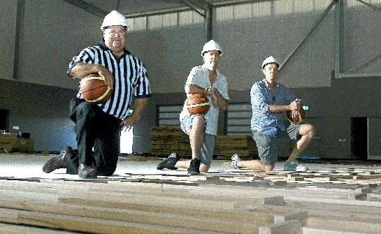 Chris Pearson, Phil Pyne and Bret Madden cast their eyes over the contruction of the basketball courts at the Byron Regional Sports and Cultural Complex.