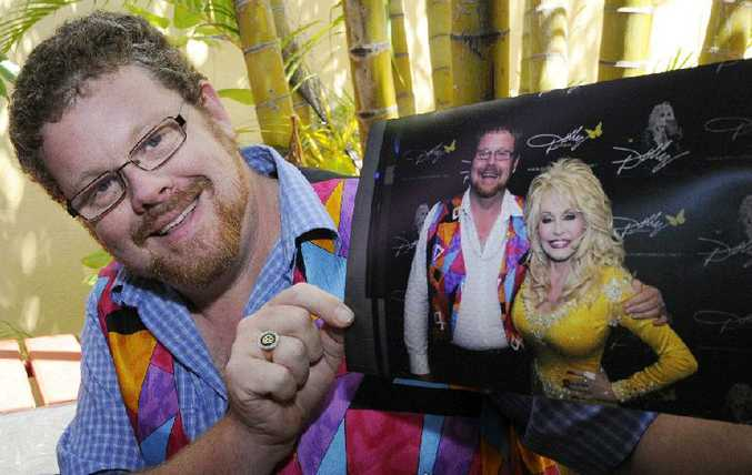 Joshua Fussell of Casino with one of his idols, Dolly Parton, who he met backstage at her recent Brisbane concert. He even got to sing with the megastar.