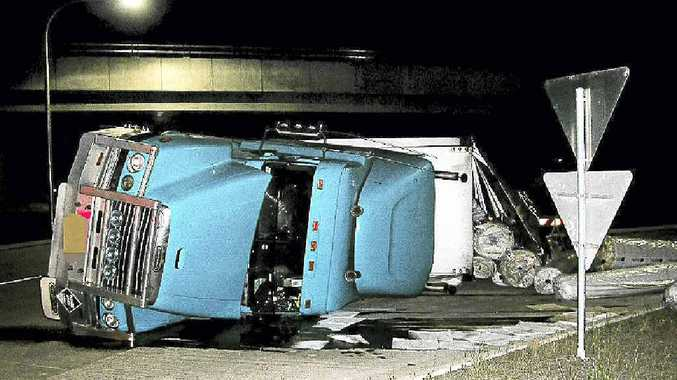 The driver of this truck, which rolled at the Teven interchange on Tuesday night, walked away with only an injured shoulder. It was the second such incident on the new piece of road in eight days.