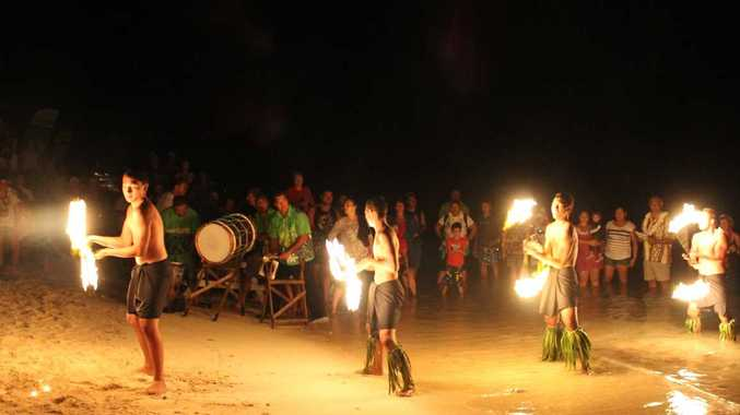 CULTURE: Whitsunday paddlers enjoyed their entire experience in the Cook Islands. Here residents from Rarotonga are showing off the art of fire twirling. Photo Contributed